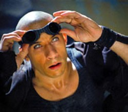 PACIFIC TITLE DIGITAL / UNIVERSAL - MR. PEEPERS Vin Diesel wears his sunglasses at - night in The Chronicles of Riddick