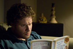 SUZANNE HANOVER / UNIVERSAL - MY FIRST READER Ben Stone (Seth Rogen) gets familiar with baby talk in Knocked Up