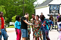 IMAGE IMPACT GROUP - NEIGHBORHOOD WATCH: Director Robert W. Filion interacts with his extras on the set of See the Dead.