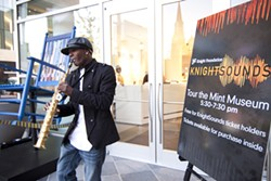 MEREDITH JONES - NIGHT MOVES: Will 'SaxMan' Smith plays his soprano saxophone during the reception before the inaugural KnightSounds' event in October 2011.