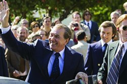 RALPH NELSON / UNIVERSAL - NOT SO PRESIDENTIAL: David Frost (Michael Sheen, background right) looks on as disgraced former president Richard Nixon (Frank Langella) tries to reconnect with the people in Frost/Nixon.