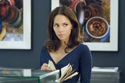 BARRY WETCHER / COLUMBIA/REVOLUTION - ON THE JOB STRAINING Rowena Price (Halle Berry) searches for clues while posing as a temp in Perfect Stranger