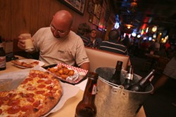 CATALINA KULCZAR - ONE GUY'S FAMOUS PIZZA: Mac Myers Jr. enjoys pizza and beer