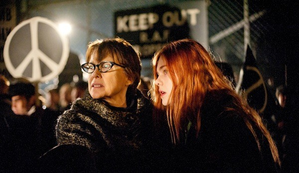 PEACEFUL PROTEST: Bella (Annette Bening) and Ginger (Elle Fanning) march on in Ginger & Rosa. (Photo: A24)