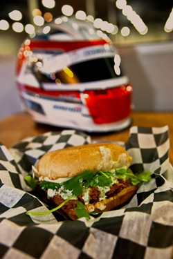 PHOTOS BY JEFF HAHNE - Pit Road Bar & Grill chef Donnie Simmons fires up a Concord sandwich.