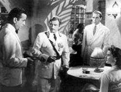 WARNER BROS - PLAYING IT AGAIN Humphrey Bogart, Claude Rains, - Paul Henreid and Ingrid Bergman in - Casablanca