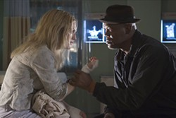 FRANK MASI / COLUMBIA - POLICE INTERROGATION Detective Samuel L. Jackson presses distraught mom Julianne Moore for answers in Freedomland.