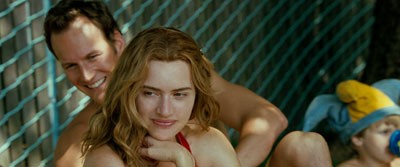 POOL PARTY Brad (Patrick Wilson) and Sarah (Kate Winslet) have fun in the sun in Little Children. - NEW LINE