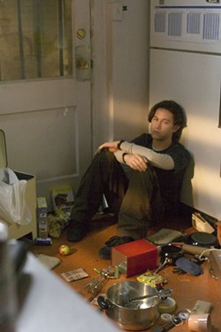 ALLEN FRASER / MIRAMAX FILMS - POUTS AND PANS Chris (Joseph Gordon-Levitt) has a crisis in the kitchen in The Lookout