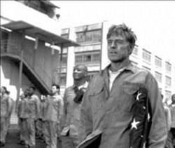 ELLIOTT MARKS/DREAMWORKS - PRISONER OF BORE Robert Redford goes through - the familiar prison flick paces in The Last Castle