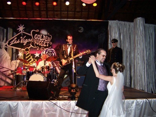 Radok (far right, background) on stage with Unknown Hinson.  (Photo courtesy of Doug Canipe)
