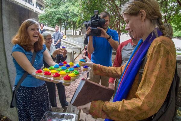 Rainbow cupcakes for everyone! - GRANT BALDWIN