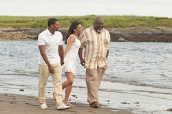 SONY PICTURES - REVEREND HIKE: Jason (Laz Alonso, left) and Sabrina (Paula Patton) take a stroll with Reverend James (Pastor T.D. Jakes) in Jumping the Broom.