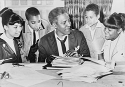 LIBRARY OF CONGRESS - Rustin speaks with civil rights activists before a demonstration, 1964