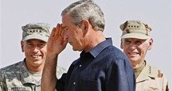 "HUFFINGTON POST - SALUTE!: The Preznit shows Gen. Petraeus his special ""thumb surge"" nose-picking technique."