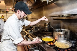JUSTIN DRISCOLL - Sam Weisenhorn preps some corn in the kitchen, which finds its way to a number of dishes...
