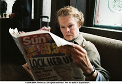 CLIVE COOTE / FOX SEARCHLIGHT - SCANDAL SHEET Barbara (Judi Dench) reads about her shamed coworker in Notes On a Scandal