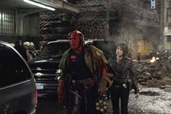 EGON ENDRENYI / UNIVERSAL STUDIOS - SEEING RED: Hellboy (Ron Perlman) and Liz (Selma Blair) survey the damage in Hellboy II: The Golden Army.