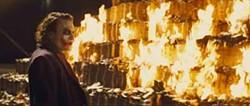 WARNER BROS. & DC COMICS - SETTING THE SEASON ON FIRE: Heath Ledger in The Dark Knight, the summer's best film.