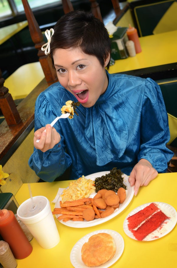Sharon Suy samples some of the magic at Angie's Diner: fried squash, sweet potato fries, mac 'n' cheese, collard greens, a biscuit, and, of course, a slice of the lovely red velvet cake. - GRAHAM MORRISON