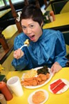 <p>Sharon Suy samples some of the magic at Angie's Diner: fried squash, sweet potato fries, mac 'n' cheese, collard greens, a biscuit, and, of course, a slice of the lovely red velvet cake.</p>