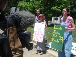 Sheila Stumph giving a TV interview in front of the statehouse on April 20, pictured with her housemate Roberta Mothershead (center) and Roberta's husband, Scott Bass (left). - JESSE DECONTO