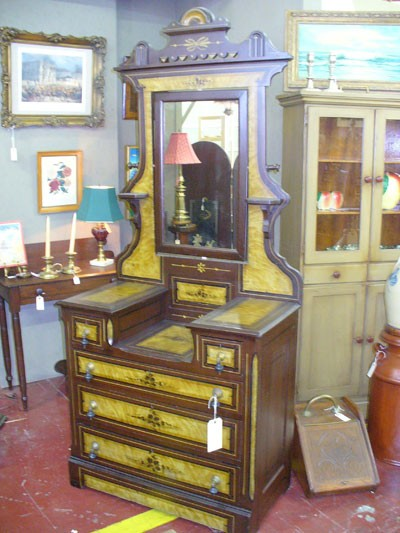 Sleepy Poet Antique Mall - 1845, grain-painted dressmakers chest, - original paint and hardware for $950.00. - 4450 South Blvd. 704-529-6369. - Monday-Thursday 10 a.m.-6 p.m., Friday-Saturday 10 a.m.-8 p.m., Sunday 12 p.m.-5 p.m. - www.sleepypoetstuff.com - Credit cards accepted