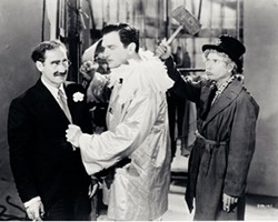 "WARNER HOME VIDEO - SO FUNNY IT HURTS: ""Smart-Aleck"" Groucho Marx (left) and ""Knockabout"" Harpo Marx (right), seen here in A Night at the Opera, are both discussed in a new book about American comedy."