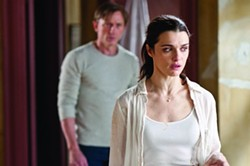 GEORGE KRAYCHYK / UNIVERSAL - SOMETHING WICKED THIS WAY COMES: Rachel Weisz and Daniel Craig in Dream House