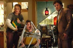 DALE ROBINETTE / COLUMBIA - STICKY SITUATION: Red (Danny McBride, center) is a captive audience for Saul (James Franco) and Dale (Seth Rogen) in Pineapple Express.