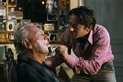 ETIENNE GEORGE / MIRAMAX - STILL STANDING: Shortly before tragedy strikes, Jean-Dominique Bauby (Mathieu Amalric) treats his father (Max von Sydow) to a shave in The Diving Bell and the Butterfly.
