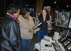 COURTESY OF NODARIOTY - STORYTELLER: Artist Martique Lorray chats with patrons at last year's All Arts Market