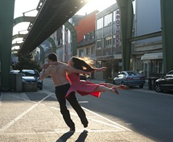 IFC FILMS - STREETS OF FIRE: Members of the Tanztheater Wuppertal engage in an incendiary outdoor dance in Pina.