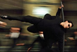 WARNER BROS - SWINGING INTO ACTION Keanu Reeves takes the - pole position in The Matrix Reloaded