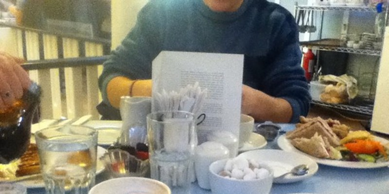 Taken at Willow Tea Rooms in Glasgow's city centre, and the dishes in front of me are a cream scone with jam and a cappuccino