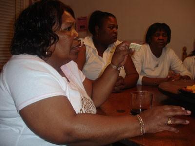 "Teresa Shepard, Regina Diane Glover and Katie Glover mourn the death of Teresa and Katie's brother Willie ""Junior"" Brown - JESSE DECONTO"