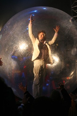 The Flaming Lips' frontman Wayne Coyne rolls out into the crowd. (The Echo Project, Atlanta, Oct. 12-14)
