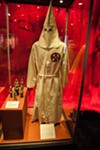<p>The Ku Klux Klan killed and terrorized African Americans as well as Jews, Italians, Mexicans and others. Members of the Klan sometimes wore clothing like the robe and hood above. </p>