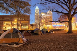 GRANT BALDWIN - The Occupy Charlotte campsite at Old City Hall on East Trade Street at dusk on Nov. 26.