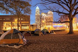 GRANT BALDWIN - The Occupy Charlotte campsite at old City Hall on East Trade Street at dusk on Nov. 26, 2011.