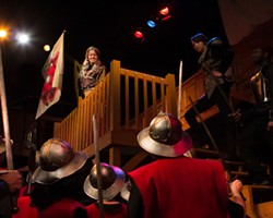 SHAKESPEARE CAROLINA - The title character in Queen Margaret, played by Katie Bearden, looks down upon the troops.