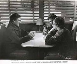 COLUMBIA PICTURES - THE VOICE OF REASON: Sam the Lion (Ben Johnson, left) palavers with Sonny (Timothy Bottoms) and Billy (Sam Bottoms) in The Last Picture Show.
