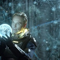 THE WORLD IN HIS HANDS: David (Michael Fassbender) is all aglow over his discovery in Prometheus. (Photo: Fox)