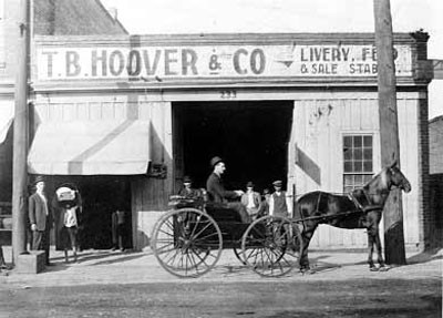 Thomas B. Hoover in the early 1900s on a carriage outside his livery stable at 21 North College Street.
