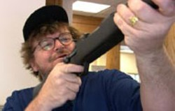 UNITED ARTISTS - THREE-GUN SALUTE Cheers to Michael Moore for - his Oscar rant