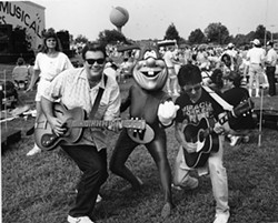 THREE STOOGES: John Grooms (left), Fred Mills (right) and friend performing at the Gaffney Peachoid
