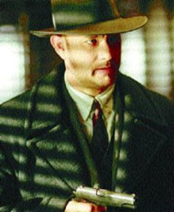 FRANCOIS DUHAMEL/DREAMWORKS - TOMMY GUN Tom Hanks aims for a hit in Road to - Perdition