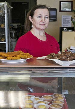 ASHLEY GOODWIN - TROPICAL DELIGHTS: Owner Maria Costa displays some of the offerings at Tropical Bakery & Cafe.