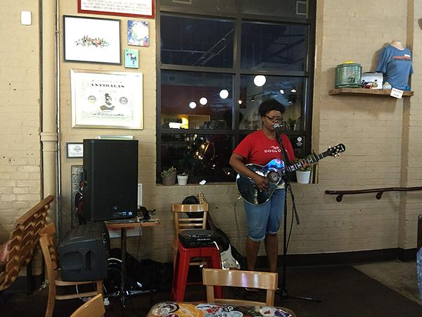 Johnson performs at the Rhino Market. (Photo by Kia Moore)