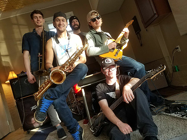 AKITA is ready to funk you up: Dan Hamalainen (from left), Charlie Lampercht, Patrick Buckley, Sam Farnham and Zak Ferrell (seated). (Photo by Jamar Perry)